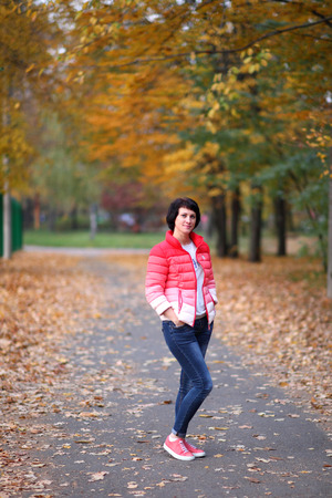 Girl in the autumn park.