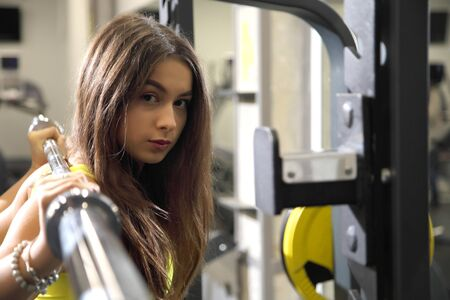 Young girls doing fitness exercises in the gym. Training in the gym for body shaping.