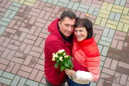 Mature couple with a bouquet of flowers. Mature couple.