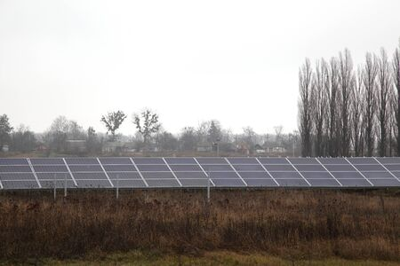 Solar panels near a rural road. Installation of solar panels in rural areas.