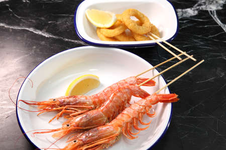 Beer pub. Langoustines and beer. Beer and seafood snacks. Langoustines, beer, squid rings.