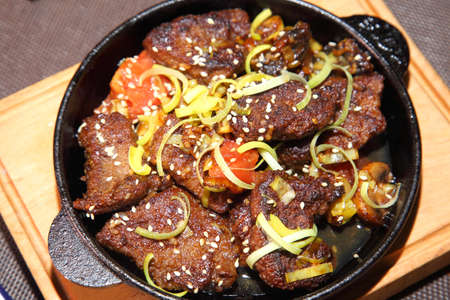 Fried beef liver with onions. Beer pub. Sports bar.
