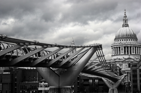 millenium bridge and st paul cathedral taken on cloudy day photo