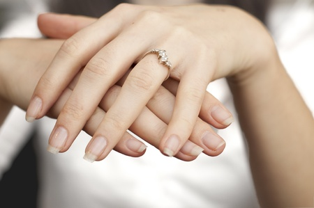 jewel hands: an image of engagement ring inserted into finger