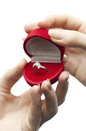 an image of red engagement box holding by hand of young girl photo