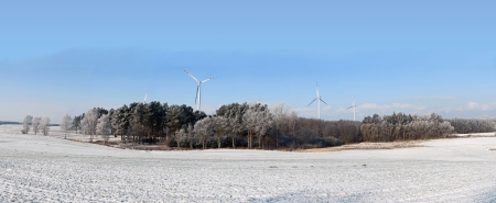 An image of winter scenery with windturbines in the background  photo