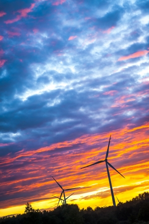 A silhouette of windturbines on a amazing sunset Stock Photo - 16034449