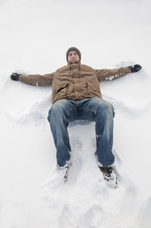 An image of man lying on the snow photo