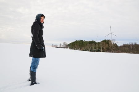 An image of girl posing outdoor in winter