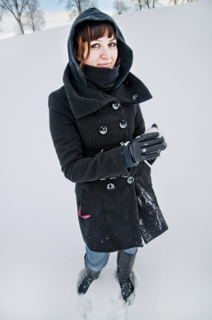An image of girl posing outdoor in winter photo