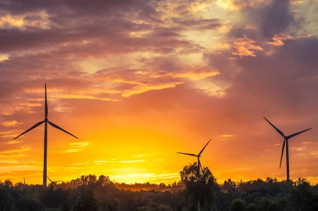 A silhouette of windturbines on a amazing sunset Stock Photo - 16034458