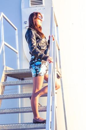 windturbine: Girl standing on entrance to windturbine