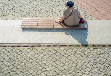 An image of lonely women sitting on the banch Stock Photo - 16034393
