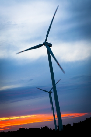 windturbines: An image of windturbines against blue sky Stock Photo