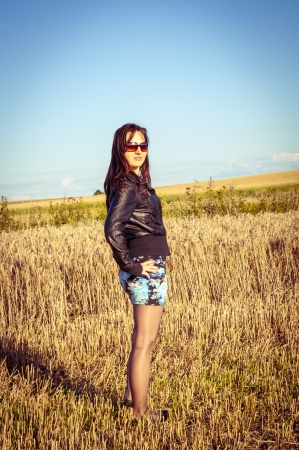 An image of brunette girl portrait in the field Stock Photo - 16216484