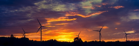 A silhouette of windturbines on a amazing sunset Stock Photo - 16232014
