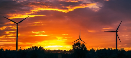A silhouette of windturbines on a amazing sunset Stock Photo - 16231289