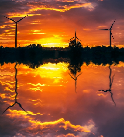A silhouette of windturbines on a amazing sunset Stock Photo - 16231971