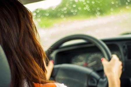 Hands of a female driver on steering wheel Standard-Bild