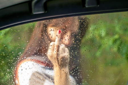 An image of girl showing her middle finger  Focus on the window Stock Photo - 16253588