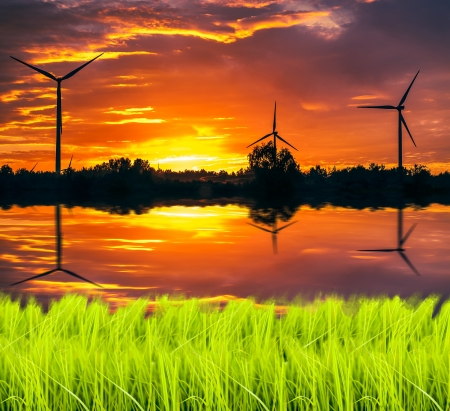 A silhouette of windturbines on a amazing sunset Stock Photo - 16288236