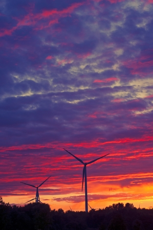 A silhouette of windturbines on a amazing sunset Stock Photo - 16287929