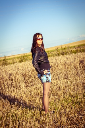 An image of brunette girl portrait in the field Stock Photo - 16253591