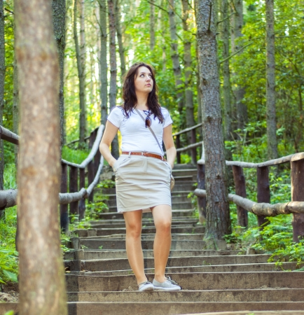 An image o girl walking through the forest pathway Stock Photo - 16253573