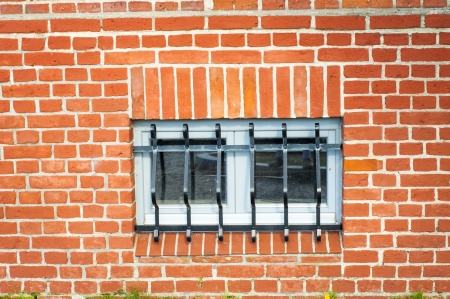 An image of jail window with grille photo