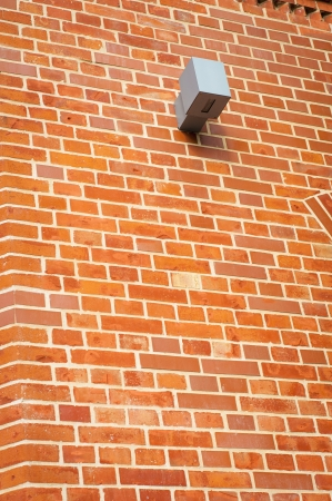 An image of security camera instaleed on red brick wall Stock Photo - 16288272