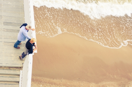 An image of adult couple at the pier watching sea waves Stock Photo - 16288186