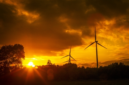 An image of windturbine during beautiful sunset