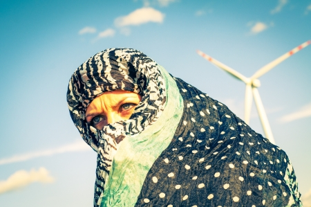 windturbine: An image of muslim girl and windturbine in the background