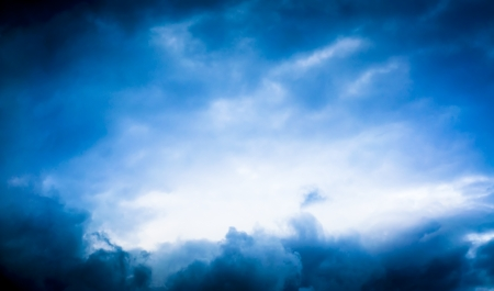 storm background: An image of blude storm cloud with bright space in the middle
