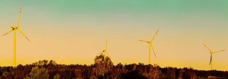 windturbines: An image of windturbines over the sunset Stock Photo