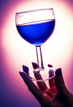An image of poisoned glass of wine photo