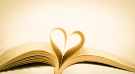 opened book and heart shape photo