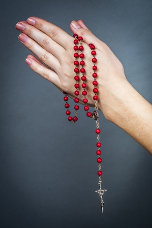 an image of rosary on female hand Stock Photo - 16477096