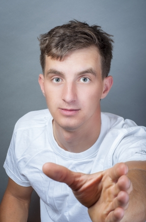 an image of young man with hand want to take something Stock Photo - 16467037