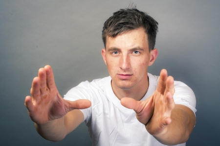 an image of young man with hand want to take something Stock Photo - 16467047