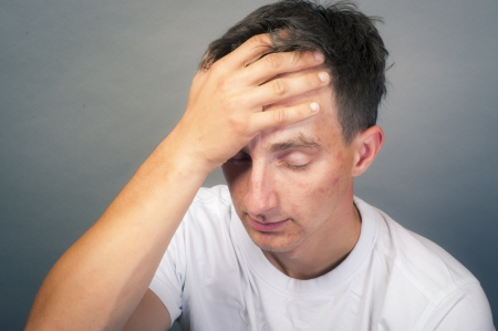 an image of upset young man photo