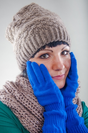 An image of young girl weraing hat and gloves Stock Photo
