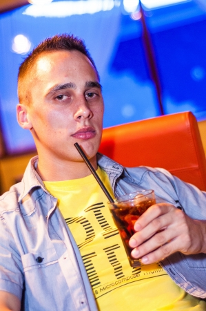 An image of man with drink at the bar photo
