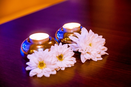 An image of White flowers and candles on the table photo