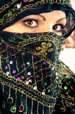 An image of muslim girl, studio shot Standard-Bild