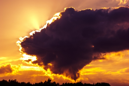 An image of Dark sky with storm clouds during sunset Stock Photo - 16915902