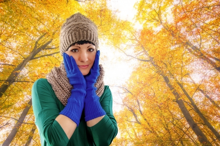 An image of girl wearing blue gloves and hat in autumn forest Stock Photo - 17287719
