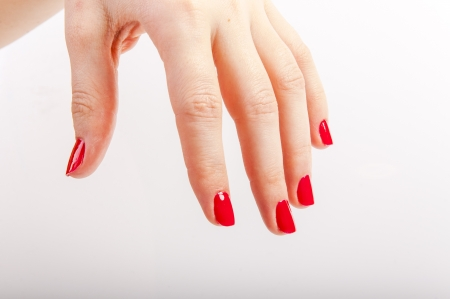 An image of female hand with red painted nails Stock Photo - 17293770