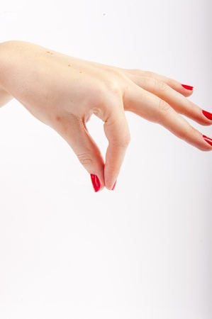 An image of female hand with red painted nails Stock Photo - 17293144