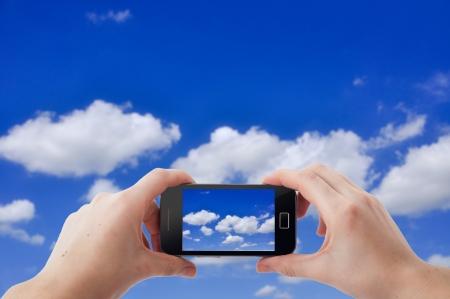 Een afbeelding van fotograferen foto's met mobiele telefoon Stockfoto